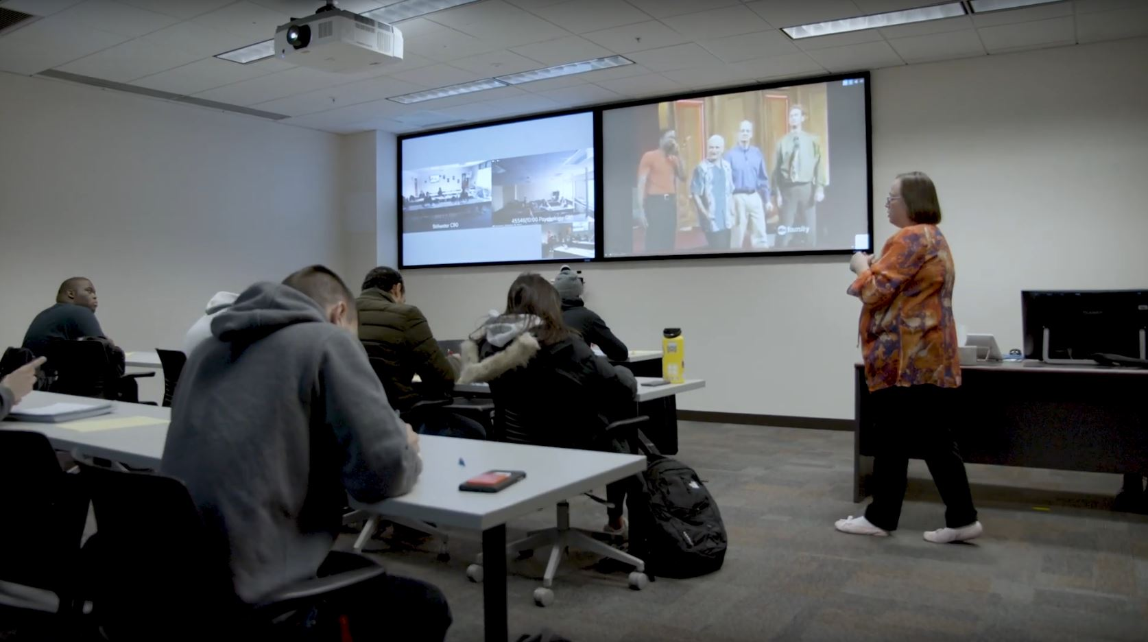 Instructor and students in a videoconference classroom